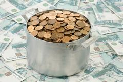Coins in an aluminium pan Royalty Free Stock Photos