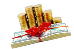 Coins and american dollars with red ribbon Stock Photos