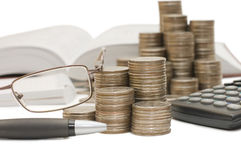 Coins And The Calculator Royalty Free Stock Images