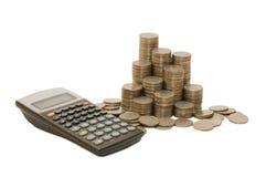 Coins And The Calculator Stock Photos