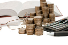 Coins And The Calculator Royalty Free Stock Photo