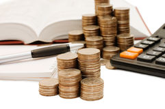 Coins And The Calculator Royalty Free Stock Photos