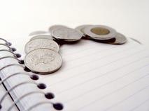 coins anteckningsbokspiral Royaltyfria Bilder