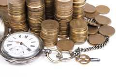 Coins and Antique pocket watch on white background Royalty Free Stock Photo