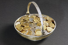 Coins in antique vase Royalty Free Stock Photography