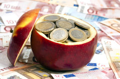 Coins on apple Royalty Free Stock Image