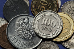 Coins of Armenia. Armenian one hundred dram coin and Armenian national coat of arms depicted in Armenian dram coins Royalty Free Stock Photo