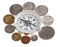 Coins around the compass Royalty Free Stock Photography