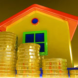 Coins Around House Showing Paying Rent Royalty Free Stock Images