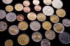 Coins Around the word  Black Background Royalty Free Stock Photography