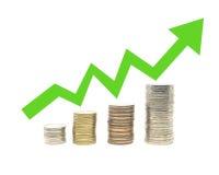 Coins and arrow Stock Photos
