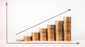 Coins and arrows graph shows company succesful income royalty free stock photos