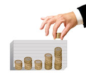 Coins  as a symbolic chart. And hand Royalty Free Stock Photo