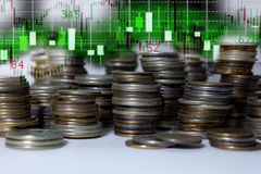 Coins on the background stock quotes graphs Stock Photo