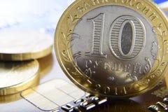Coins on a bank card Royalty Free Stock Photos