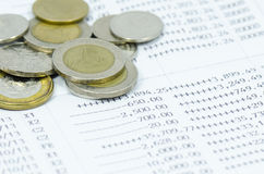 Coins on bank statement Stock Photo