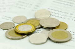 Coins on bank statement Stock Photos