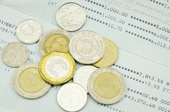 Coins on bank statement Stock Images