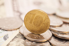 Coins on banknotes Royalty Free Stock Image