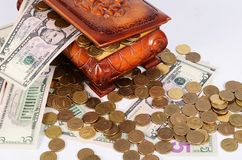 Coins and banknotes in the box Stock Photos
