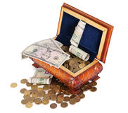 Coins and banknotes in the box Stock Images