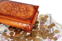 Coins and banknotes in the box Stock Photo