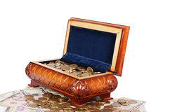 Coins and banknotes in the box Stock Photography
