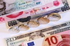 Coins and banknotes from china, japan, europe, usa, uk. Original macro photo world currency Royalty Free Stock Photos