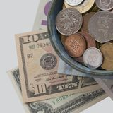 Coins and banknotes from different countries stock images