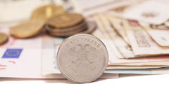 Coins on banknotes Stock Photography