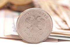 Coins on banknotes Royalty Free Stock Images
