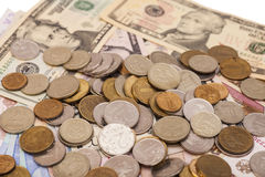 Coins on banknotes Stock Image