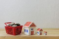 Coins in a basket red and House model Stock Photography