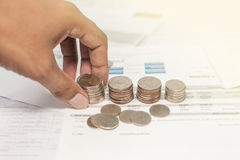 Coins and bill with hand saving for life Stock Photos