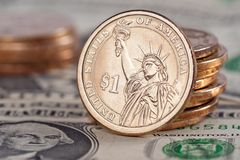 Coins and Bills. One Dollar Coins and Bills Royalty Free Stock Image