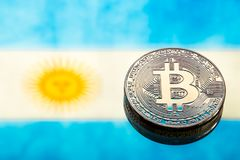 Coins Bitcoin, against the background of Argentina flag, concept. Of virtual money, close-up. Conceptual image of digital crypto currency stock image