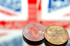 Coins Bitcoin, on a background of Great Britain and the British. Flag, concept of virtual money, close-up. Conceptual image of digital crypto currency Royalty Free Stock Image