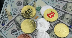 Bitcoin and cryptocurrency on banknotes of one hundred dollars. Coins of bitcoin on banknotes of one hundred dollars. Exchange bitcoin cash for a dollar stock video footage