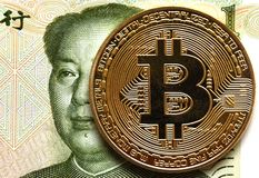 Coins Bitcoin and China money bill yuan with Mao Zedong, China,. Cryptocurrency stock photo