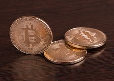 Coins bitcoin. Crypto currency. Crypto currency bitcoin on a wooden background stock photography