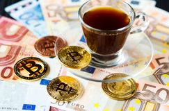 Coins Bitcoin - crypto currency and traditional money. The choice of the modern world. Investments, cryptocurrency digital payment stock photos