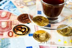 Coins Bitcoin - crypto currency and traditional money. The choice of the modern world. Investments, cryptocurrency digital payment. Concept, various of bronze royalty free stock photos