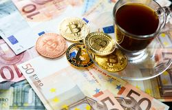 Coins Bitcoin - crypto currency and traditional money. The choice of the modern world. Investments, cryptocurrency digital payment. Concept, various of bronze royalty free stock photo