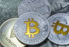 Coins of bitcoin and ethereum on dollar notes. Close up photo royalty free stock photo
