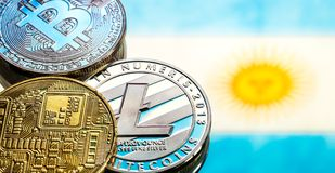 Coins Bitcoin and litecoin, against the background of Argentina flag, concept of virtual money, close-up. Conceptual image. Coins Bitcoin and litecoin, against stock photography