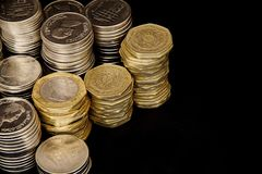 Coins on black background Royalty Free Stock Images