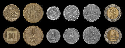 Coins on the black Stock Images
