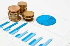 Coins and blue chart. Stack of coins on a blue business chart Royalty Free Stock Image