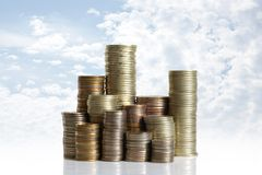 Coins on blue sky. Background Royalty Free Stock Images