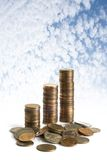 Coins on blue sky. Background stock photos